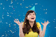 Girl under falling confetti