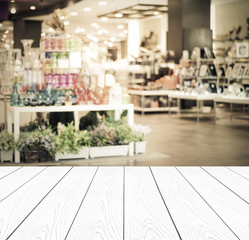 White wood perspective and blurred store with bokeh background