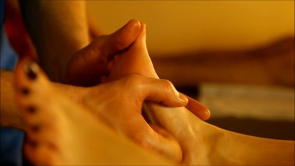 foot massage for couple in the warm atmosphere of the salon