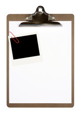 Clipboard with blank polaroid