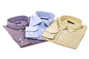 folded shirts on white