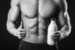 Male bodybuilder shows that milk is good.