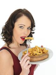 Young Woman Eating Jumbo Sausage and Chips