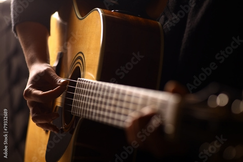 Acoustic guitar detail - 79332689