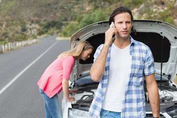 Young couple after a car breakdown