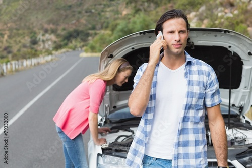 Young couple after a car breakdown - 79332800