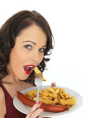 Young Woman Eating Saveloy Sausage with Chips