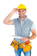 Portrait of smiling manual worker holding clipboard