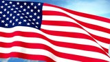 USA US Flag Closeup Waving Against Blue Sky Seamless Loop CG