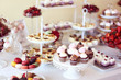 cupcakes,macaroons and sweets in a candy bar - 79335876