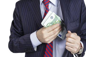 Businessman pocketing a bribe