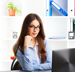 Adorable business woman working at her desk with laptop