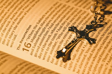 Open bible and silver crucifix