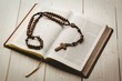 Leinwanddruck Bild - Open bible and wooden rosary beads