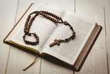 Open bible and wooden rosary beads - 79337412