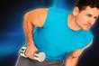 Composite image of fit young man exercising with dumbbell