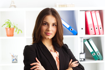 Close-up of pretty smiling woman expert wearing business suit