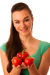 Beautiful asian caucasian woman with tomato and pepper in her ha