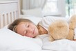 Little girl sleeping in her bed - 79338494
