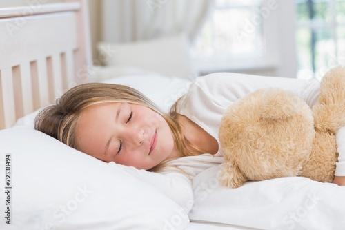 Little girl sleeping in her bed - 79338494