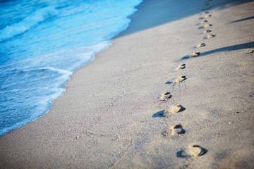 footprints in the sand by the sea