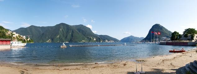 Lake Lugano, Monte San Salvatore ,and the flags of Switzerland,