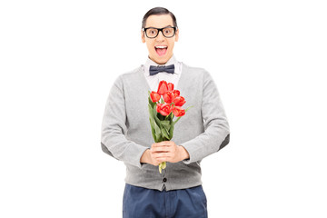 Excited man holding a bouquet of tulips