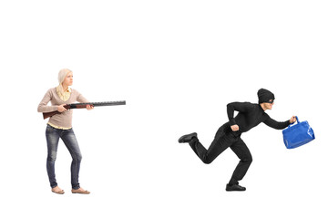 Angry woman chasing a burglar with a shotgun