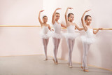 Fototapety Group of four little ballerinas practicing