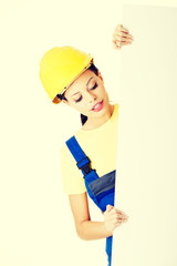 Female constructor with empty space.