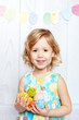 baby holding Easter eggs