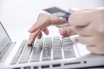 Female hands entering credit card information into a laptop