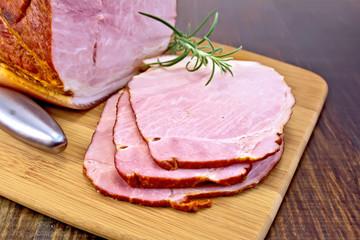 Ham smoked with rosemary on dark board