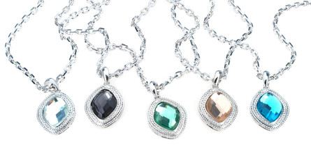 set of chains with chrystal  pendants isolated on white
