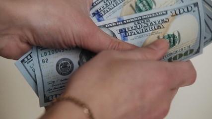 man`s hands counting money