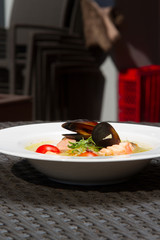 Image of tasty salmon soup with oysters in dish