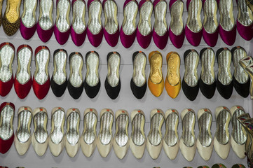 Different shoes in rows