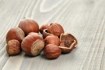 organic hazelnuts on wood table