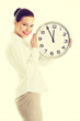 Smiling woman holding big clock.