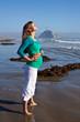 Pregnant woman on beach