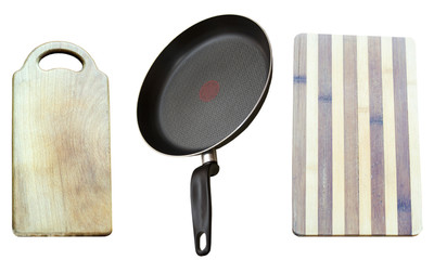 Frying pan and two wooden boards for products