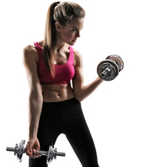 Young strong sexy woman with dumbbells
