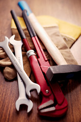 Working Tools and Gloves on a Wooden Table