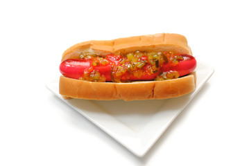 A Red Hot Dog Served with Relish on a Plate