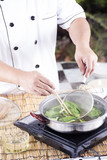 Chef scald vegetable in pot before cooking noodle poster