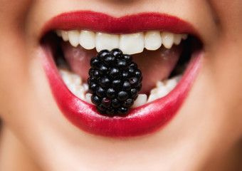 Blackberry in Woman Mouth