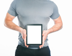 Muscular man holding tablet  isolated on white background
