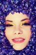 Beutiful young woman with colorful makeup.