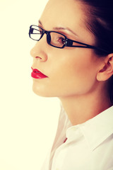 Young businesswoman with eyeglasses.