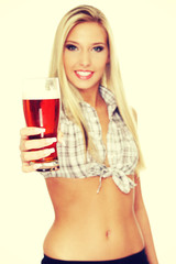 Beautiful young woman drinking beer.